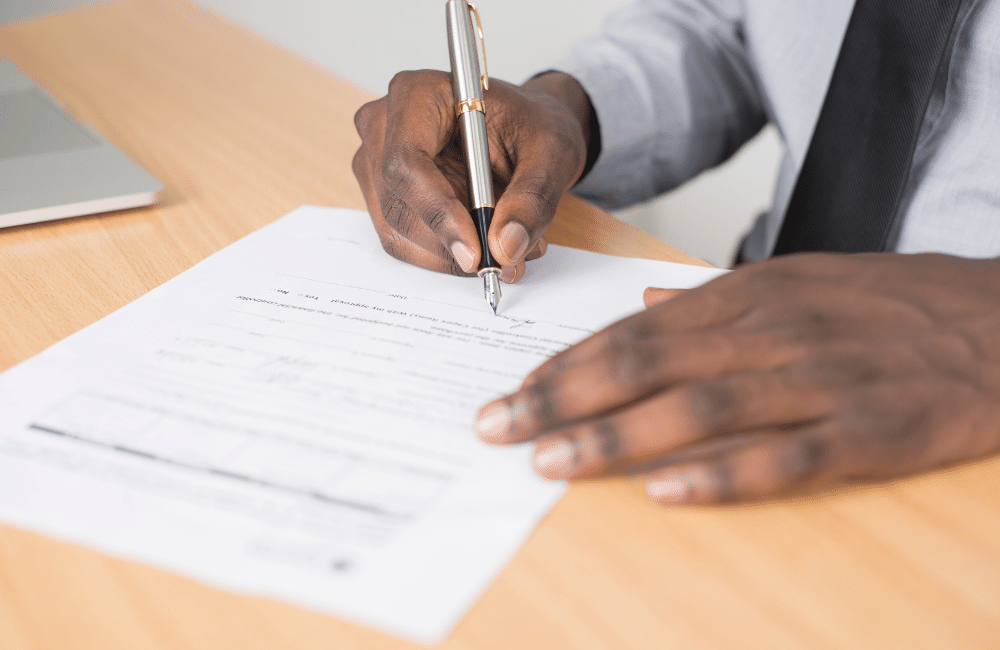 Person signing a new will package paper